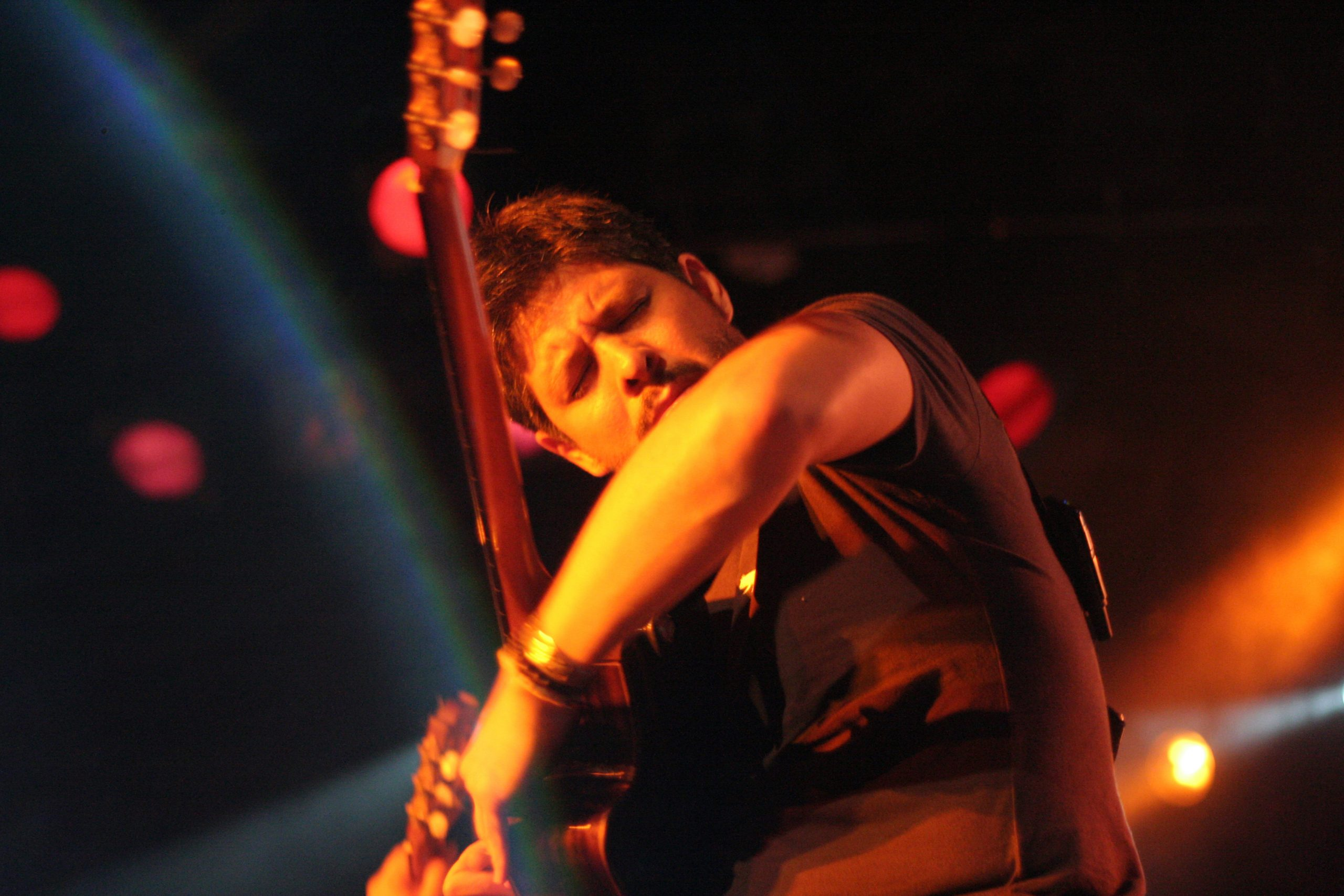 Rodrigo plays guitar on stage at a Rodrigo y Gabriela Concert in Barcelona, Spain.